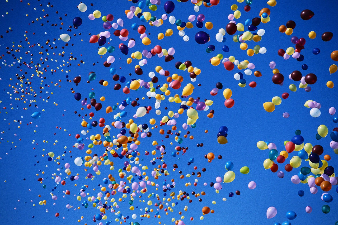 Various color balloons in the sky