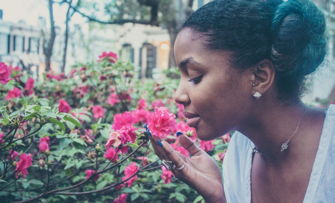Woman Smelling the Roses - Do You Neglect Caring For Yourself?