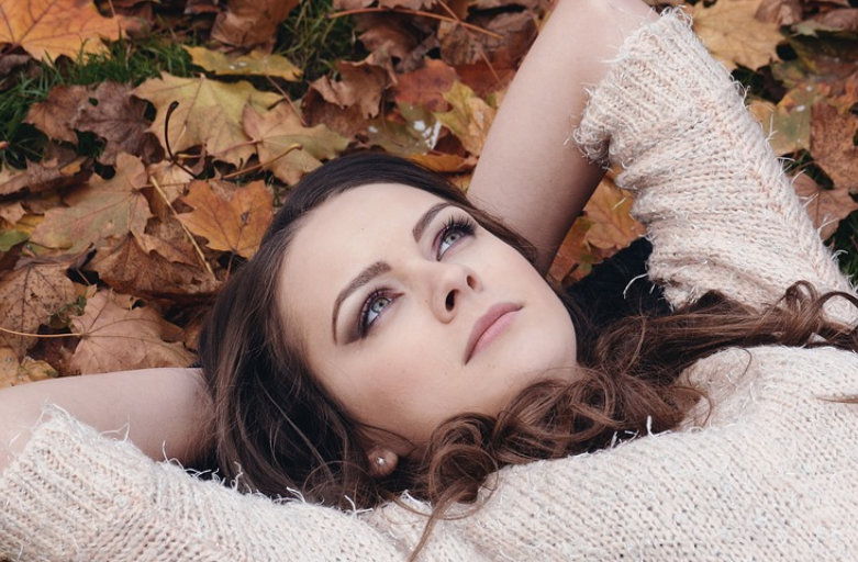 Woman lying on leaves