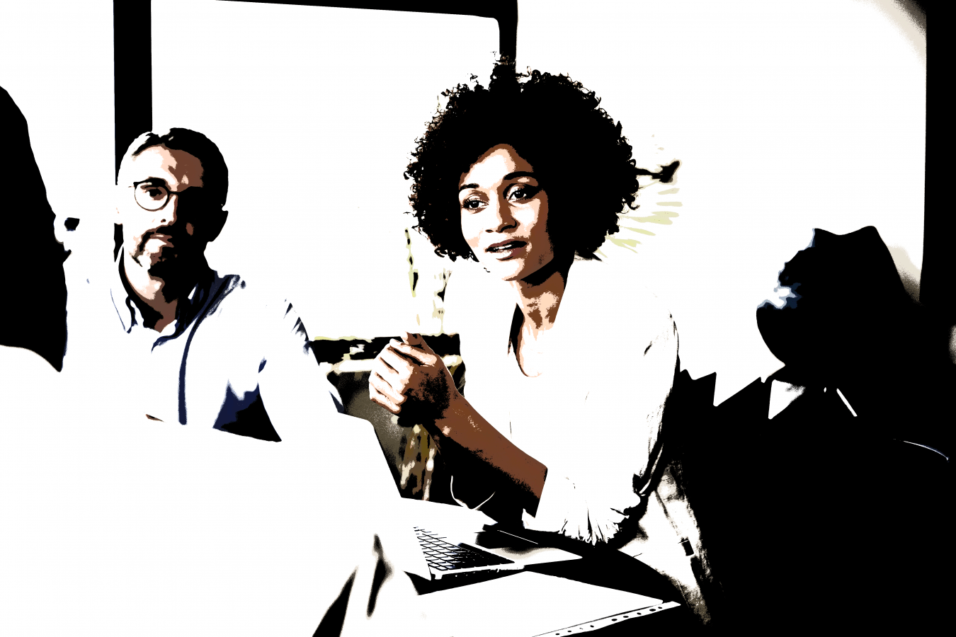 Woman Sitting at table listening to colleagues
