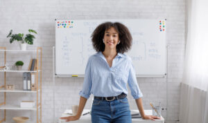 career path: Woman standing in front of desk